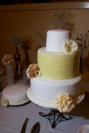 white-and-yellow-wedding-cake-with-fabric-flowers