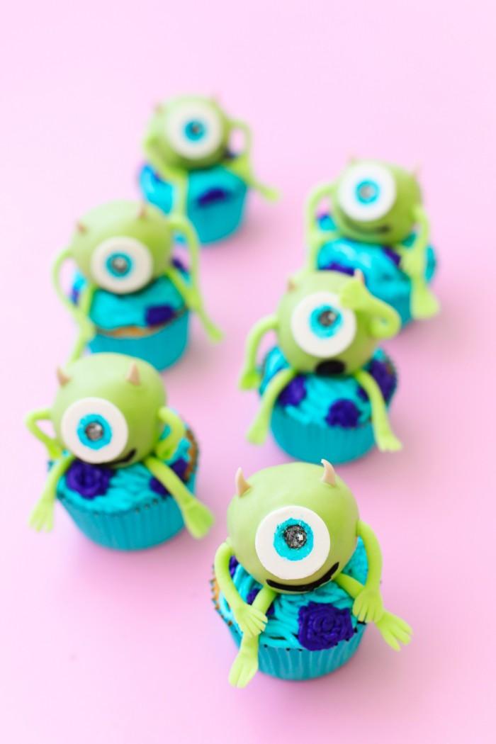 Mike Wazowski cake balls on top of cupcakes