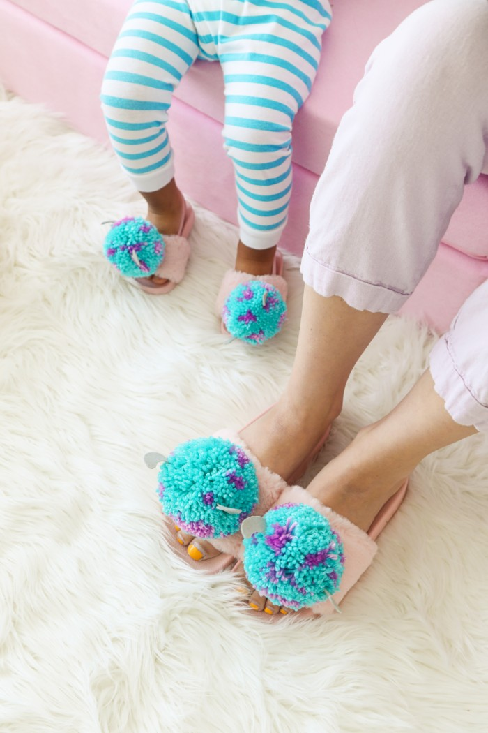 Mother and son wearing matching Monster's Inc Pom Pom slippers