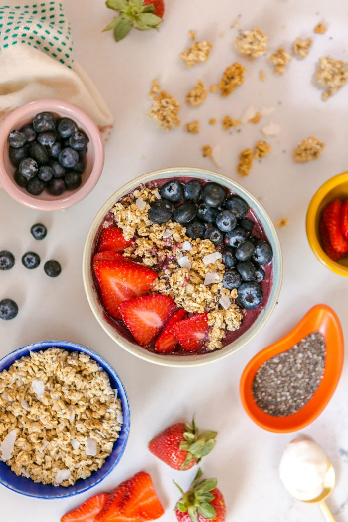 Berry Smoothie and Small Bowls of Toppings