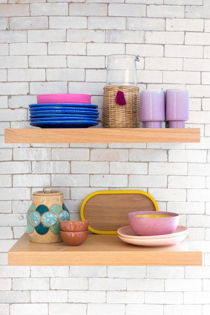 Colorful Dishes on Kitchen Shelves