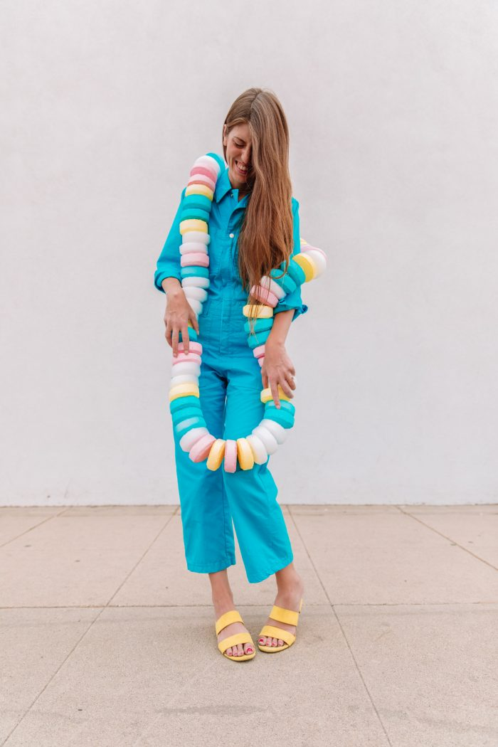 Candy Necklace Costume on woman in blue jumpsuit
