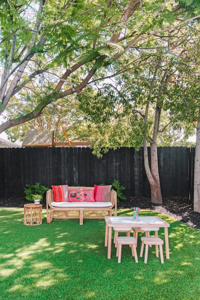 Colorful California Backyard with a Black Fence