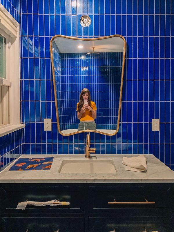 Blue Tile Bathroom with Navy Vanity