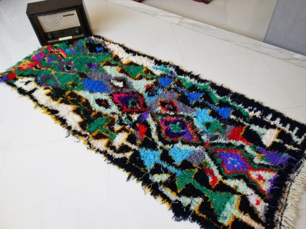 black and colorful small moroccan rug