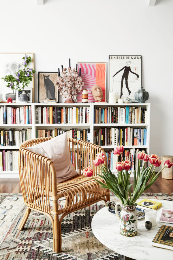 bookshelf and rattan chair