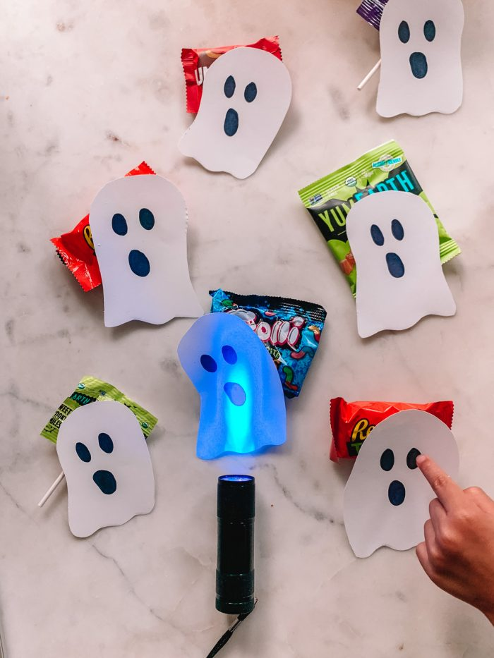 Black Light Halloween Candy Hunt with Paper Ghosts