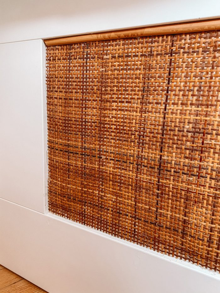 Reed along top of cane webbing on white IKEA daybed panel