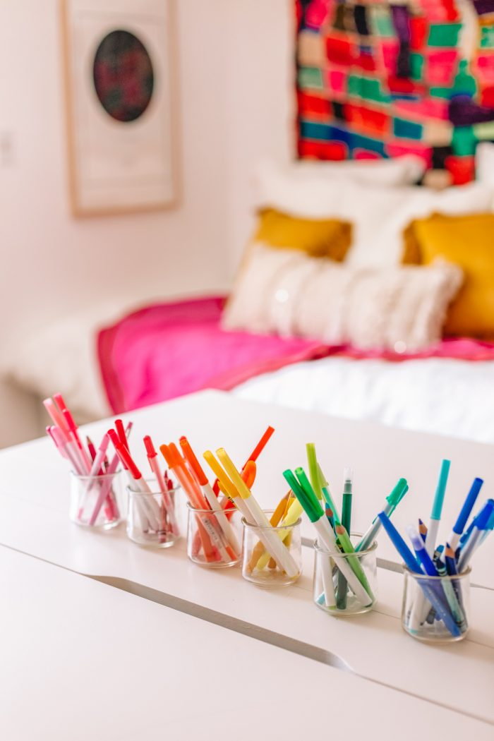 Pens organized in rainbow order in a home office
