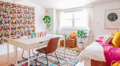 Colorful Home Office Guest Bedroom with Moroccan Rugs and Otomi Tapestry