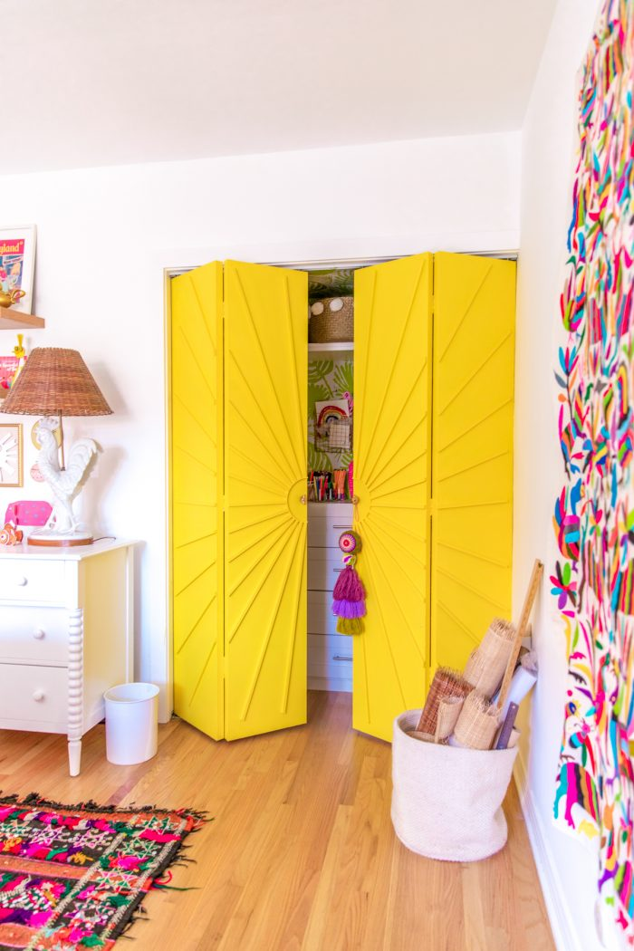 Yellow sun closet doors in a colorful home office