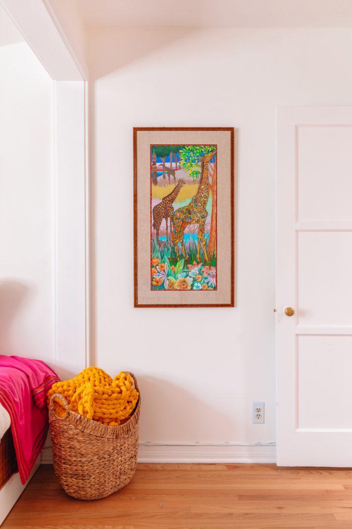 Mosaic giraffe art piece in a guest room