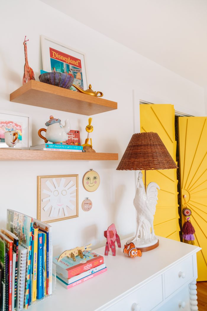 Floating shelves and extra storage in a home office guest room