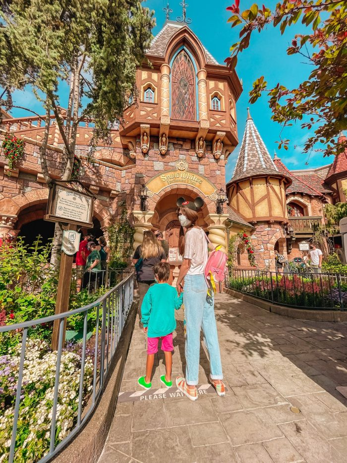 Mom and Son in front of Snow White's Enchanted Wish Disneyland
