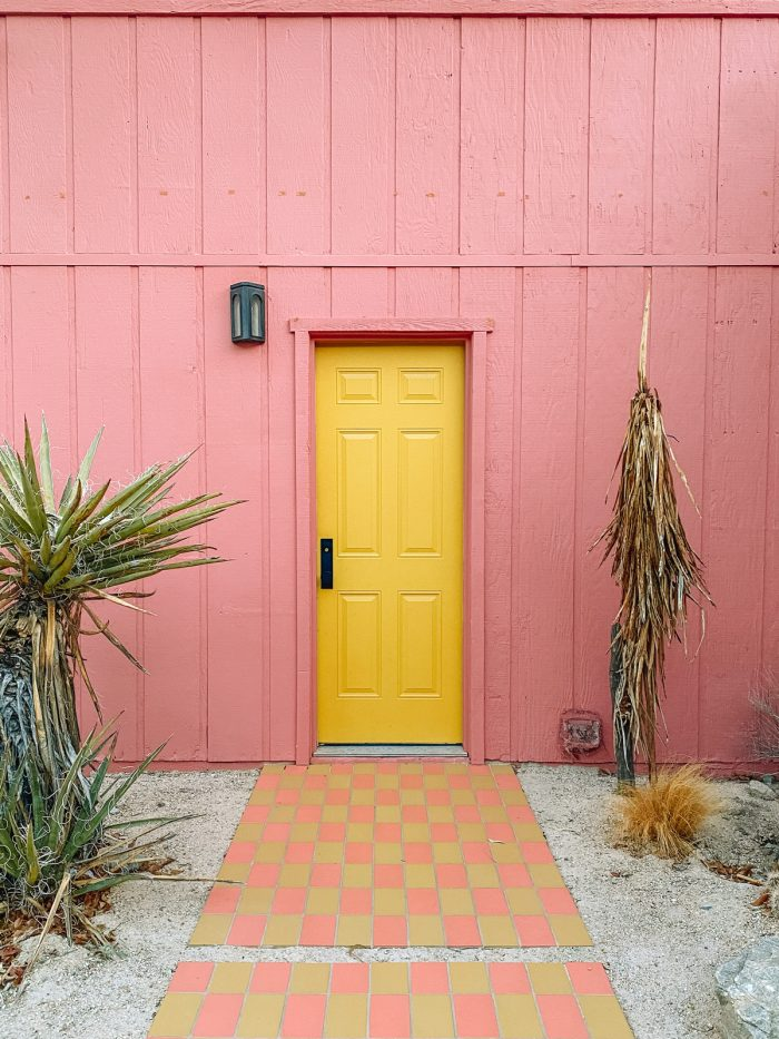Pink House with Yellow Door at Oeste in Yucca Valley
