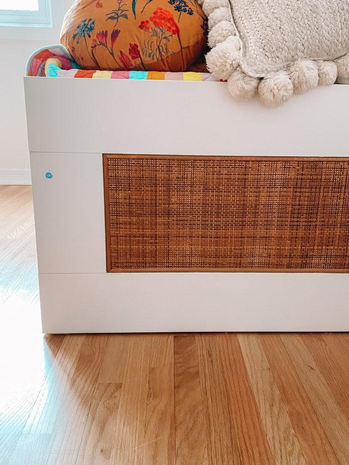 Rattan on side panel of white IKEA daybed