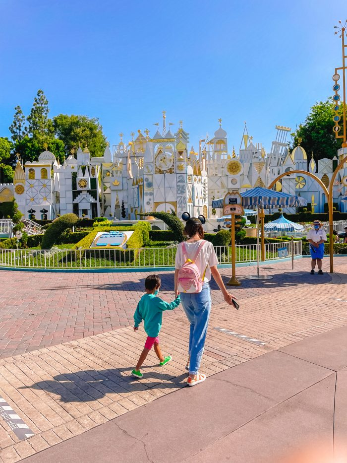 Walking in front of Its A Small World
