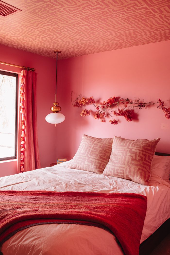Pink room with pink patterned ceiling and pink bedding