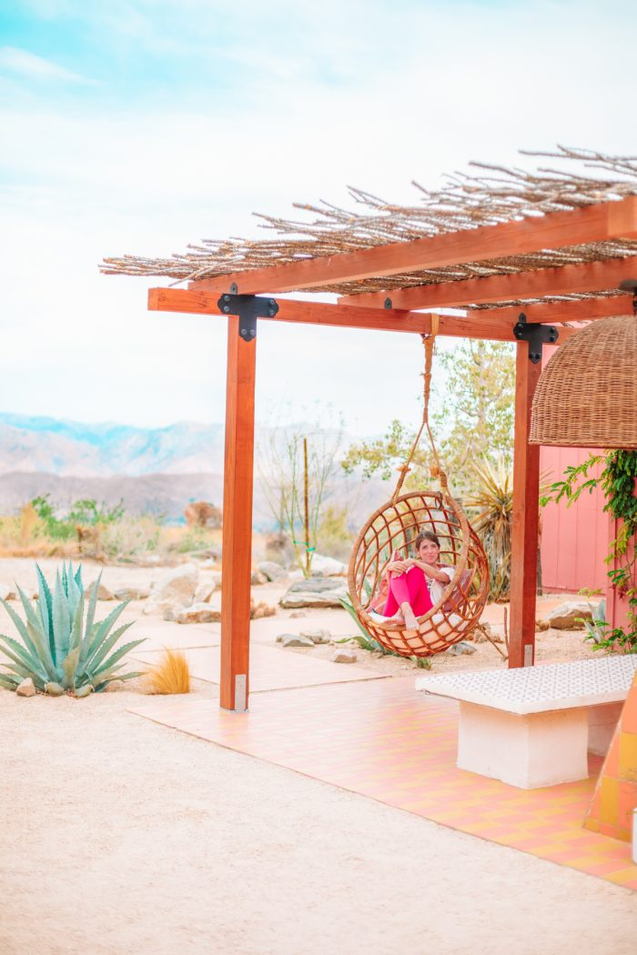 Hanging rattan chair at Oeste in Yucca Valley