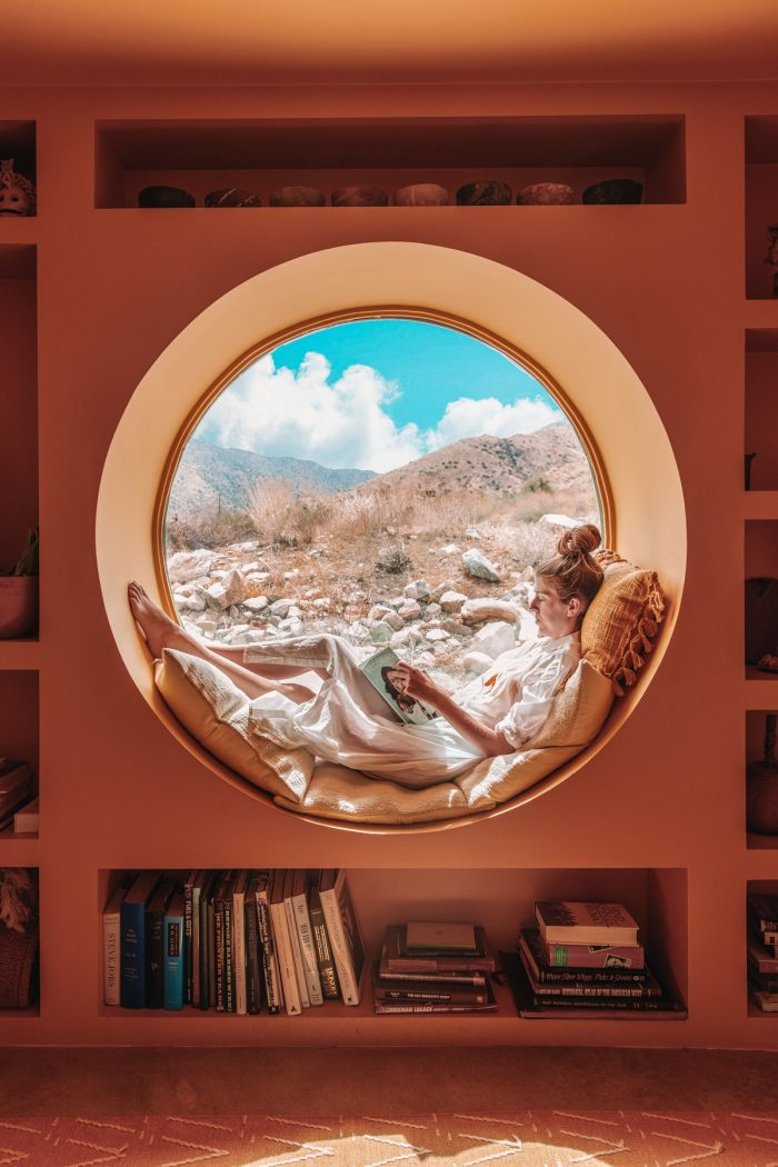 Circle window looking out on Yucca Valley desert