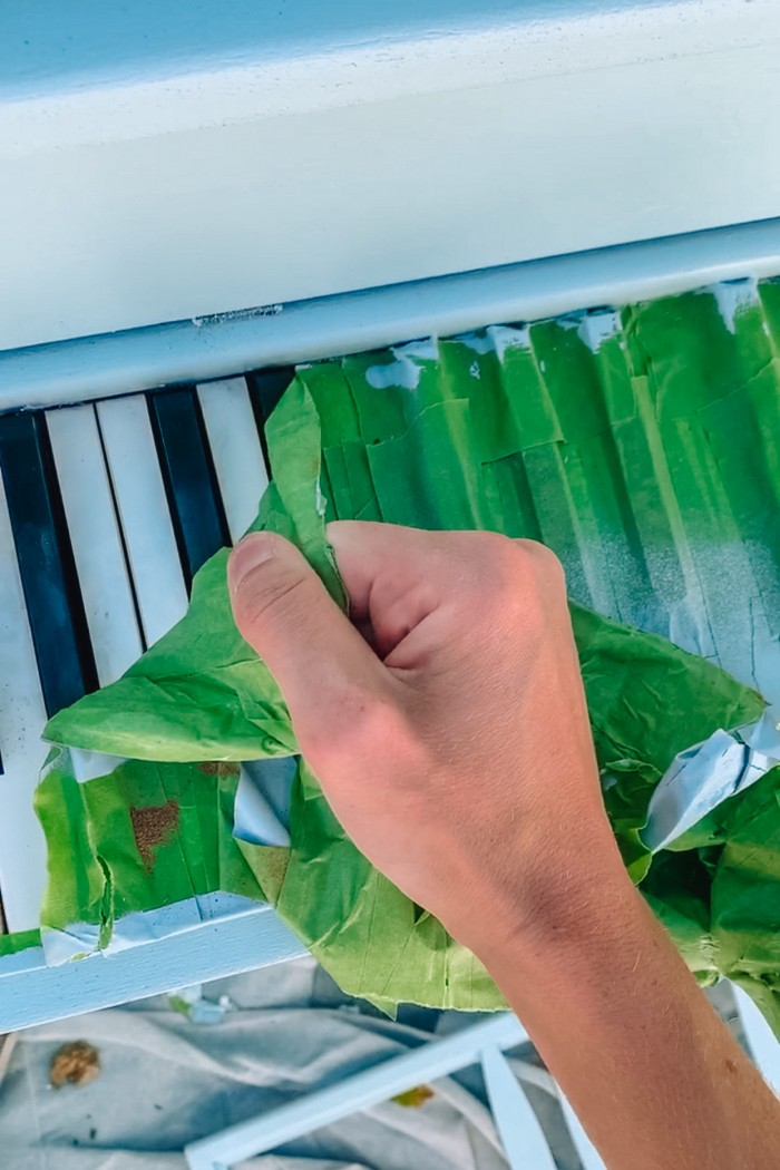 Removing painter's tape from piano keys on a painted piano