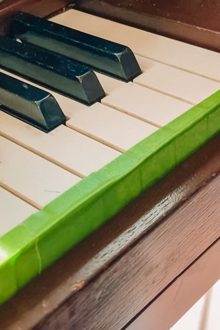 Covering piano keys in painter's tape
