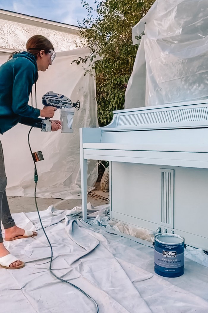 Painting a piano with a paint sprayer