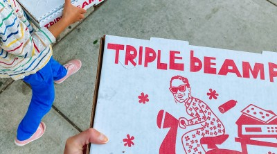 Triple Beam Pizza Boxes being carried in Los Angeles