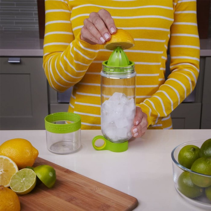 Green water bottle with lemon sitting on top