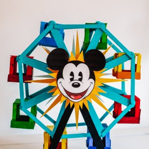 Popsicle stick Ferris wheel decorated like the Pixar Pal-A-Round from Disney's California Adventure on a white table