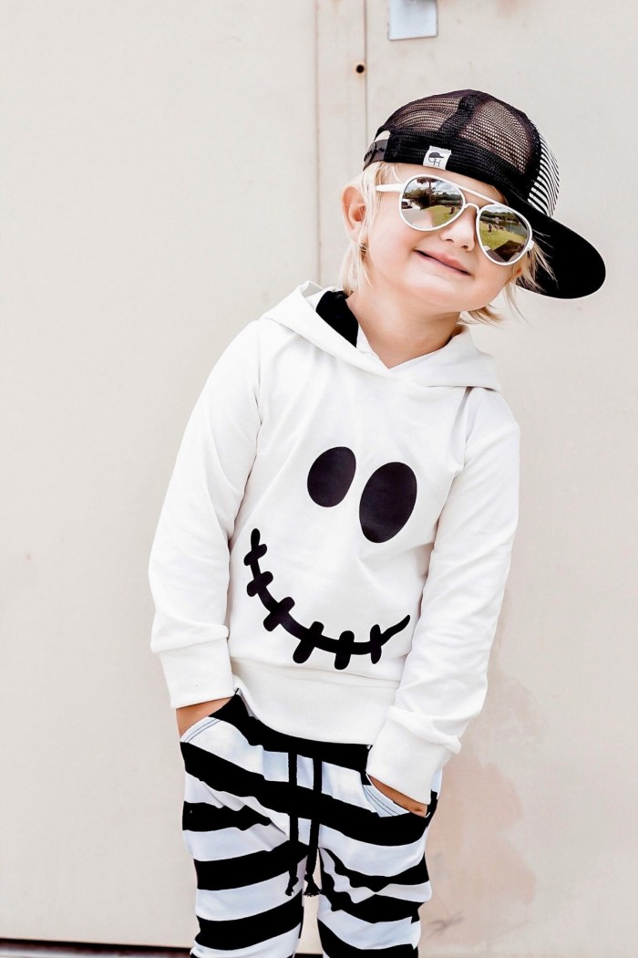 child wearing ghost hoodie and black baseball cap