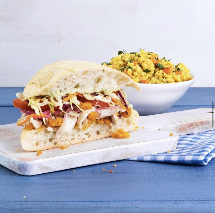 Mendocino Farms not so fried chicken sandwich on a cutting board on a table