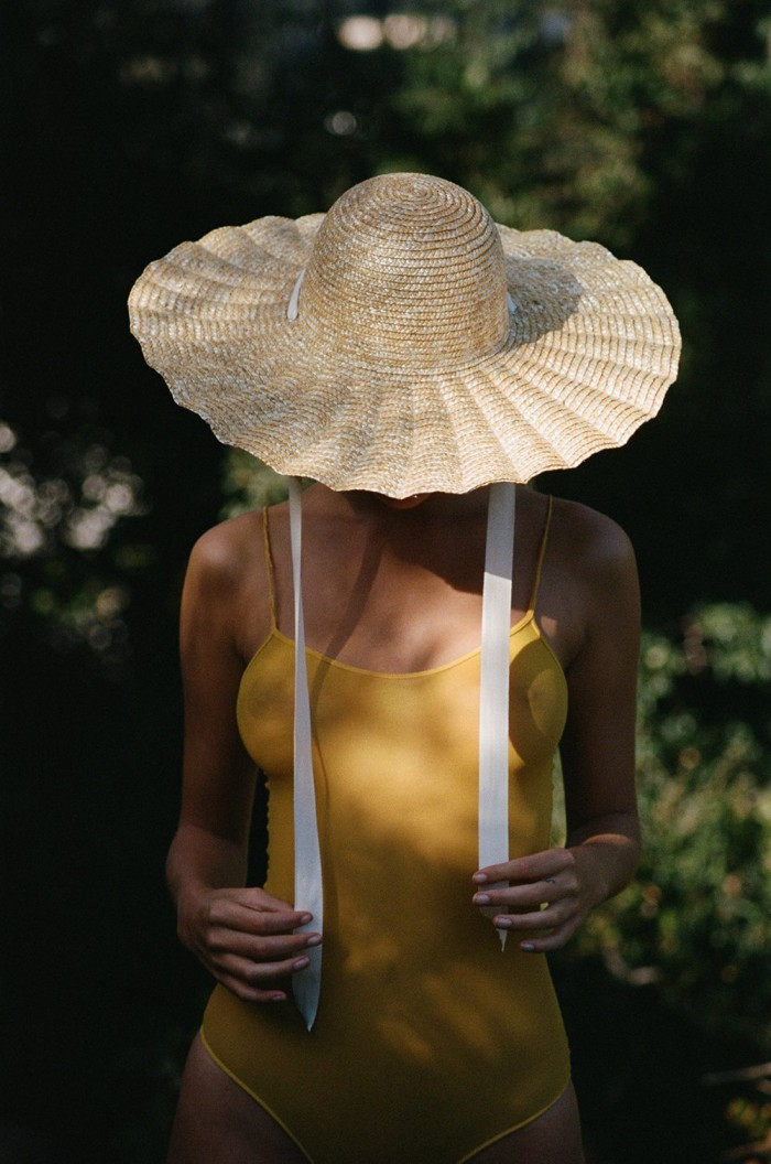 Scalloped Sun Hat on woman in a yellow dress