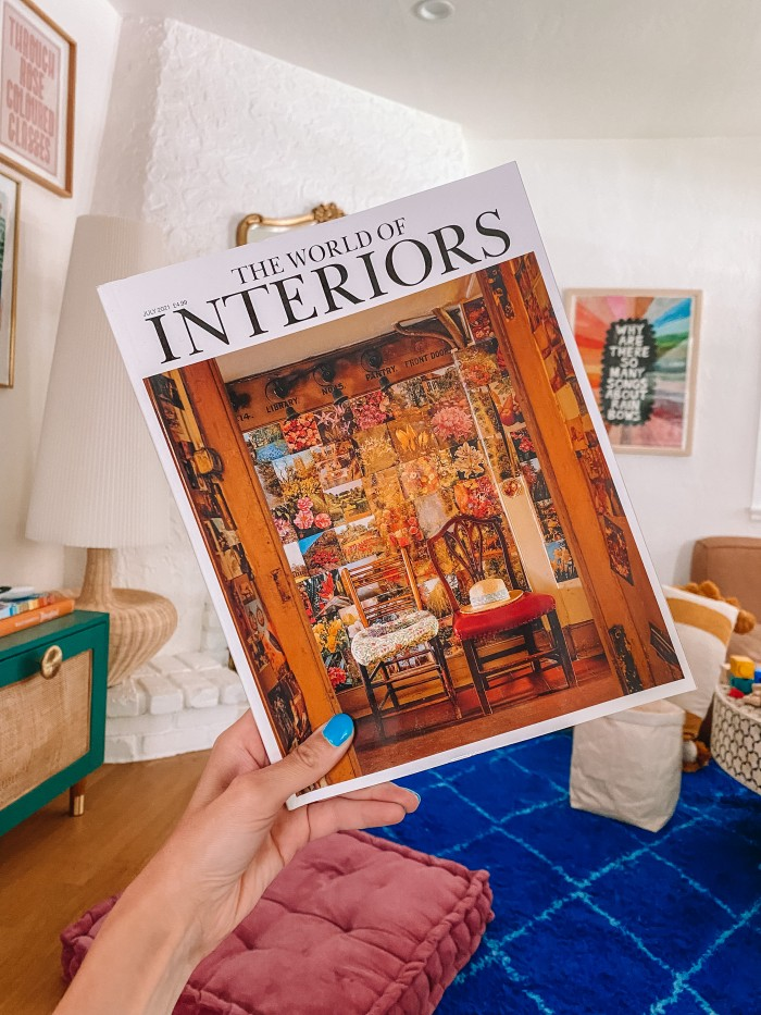 World of Interiors magazine held in front of a blue living room rug