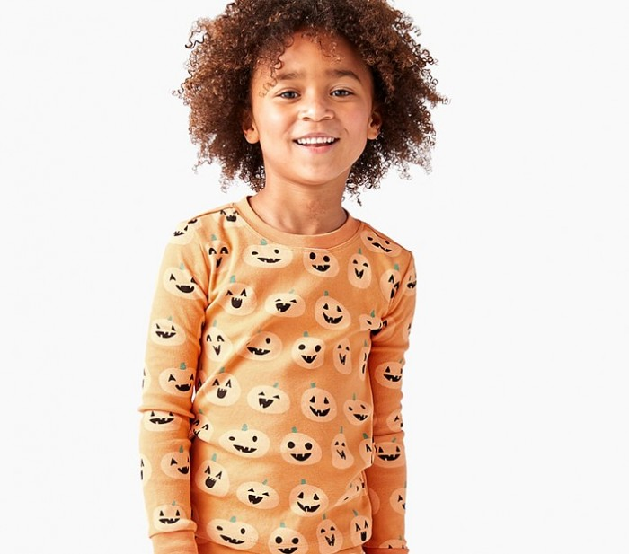 child in jack-o-lantern pajamas