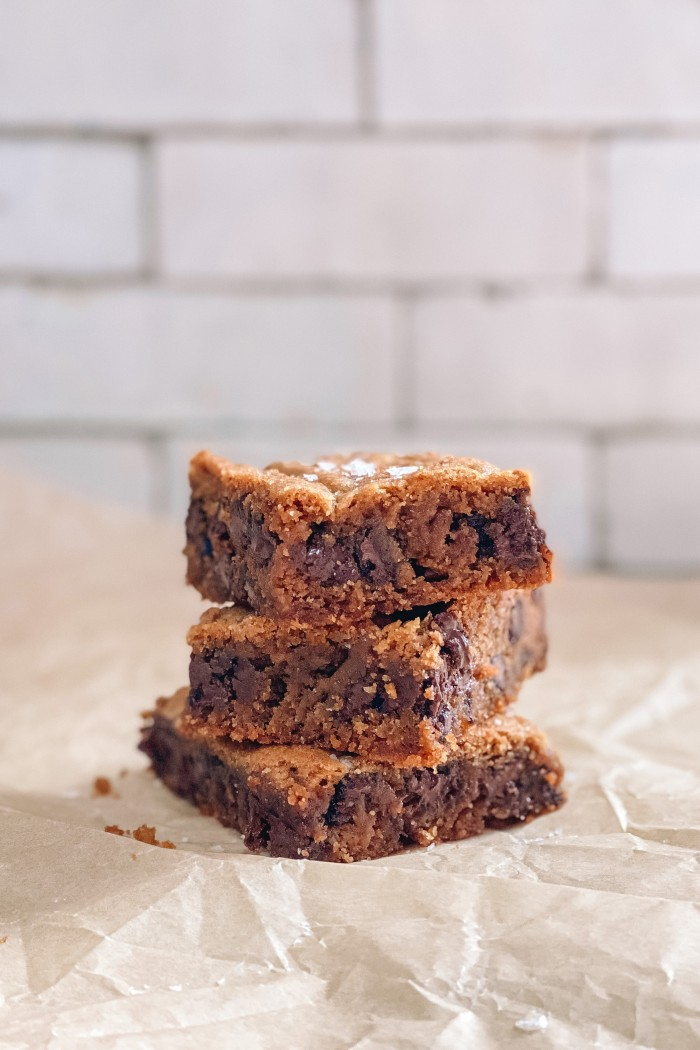 chocolate chip cookie bars stacked on parchment paper
