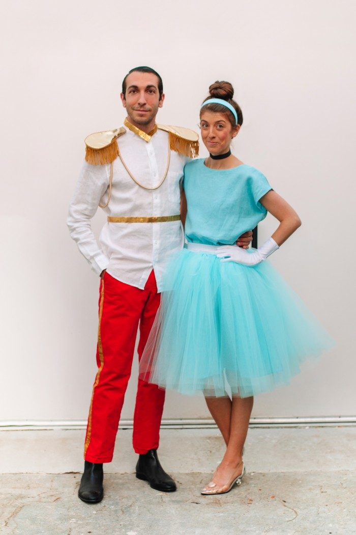 Couple dressed in Cinderella and Prince Charming Halloween costumes