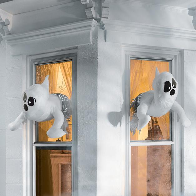 Plush ghosts crashing through the windows of a White House