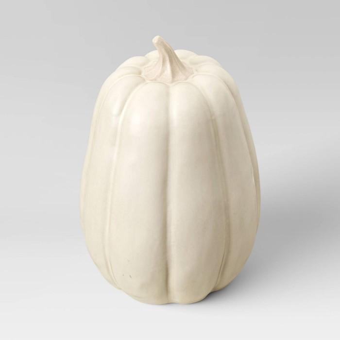 cream ceramic pumpkin on white background