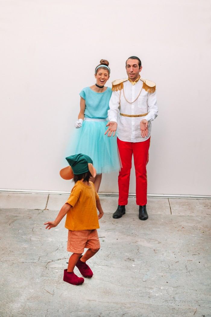 Cinderella Family Costume with Gus Gus in front of a white wall