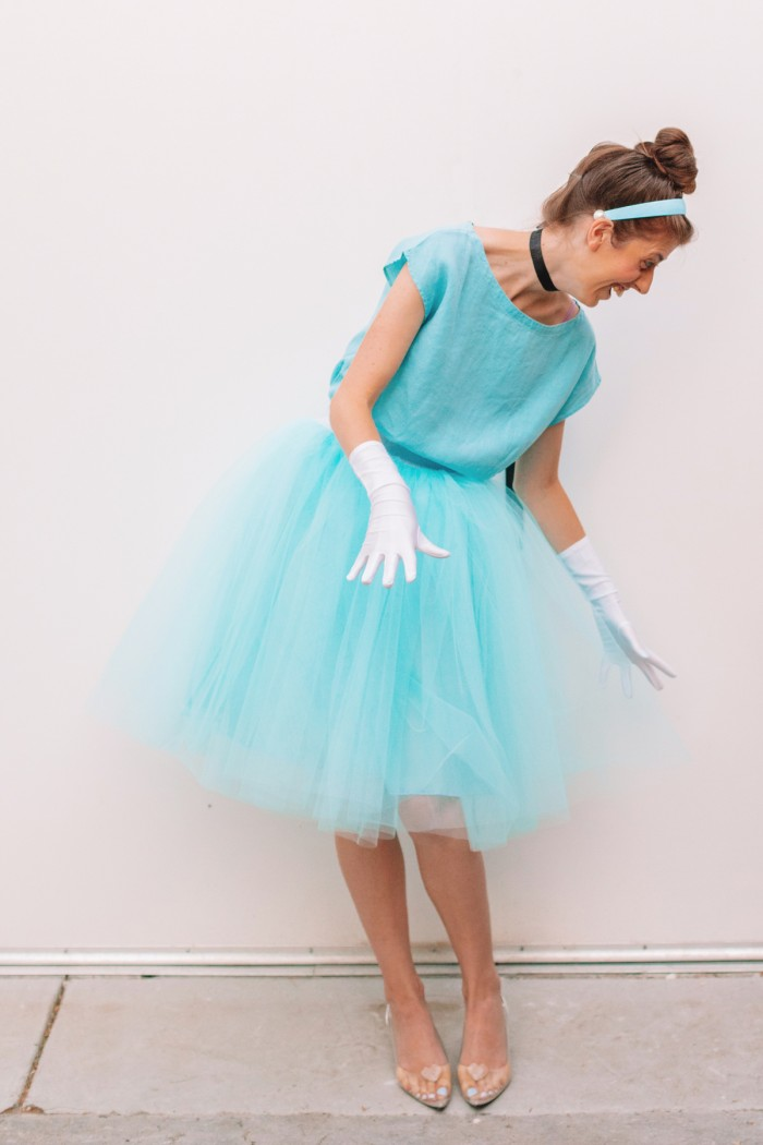 Woman in Cinderella costume in front of white wall