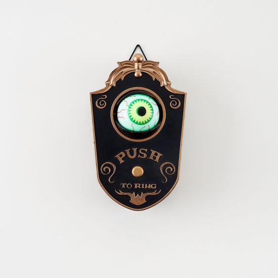 Eyeball Doorbell on a White Wall
