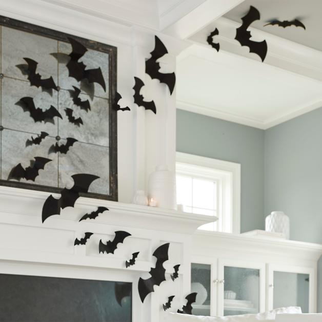 Felt bats on a white mantle and ceiling in a living room