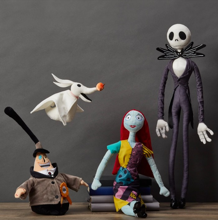 Nightmare Before Christmas plush dolls in front of a gray background