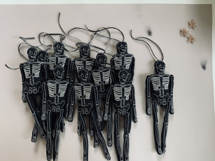Black Skeleton Dolls in a pile on a table