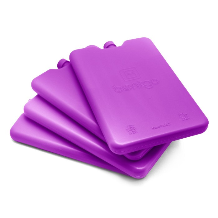 purple thin lunch box ice packs stacked on a white background
