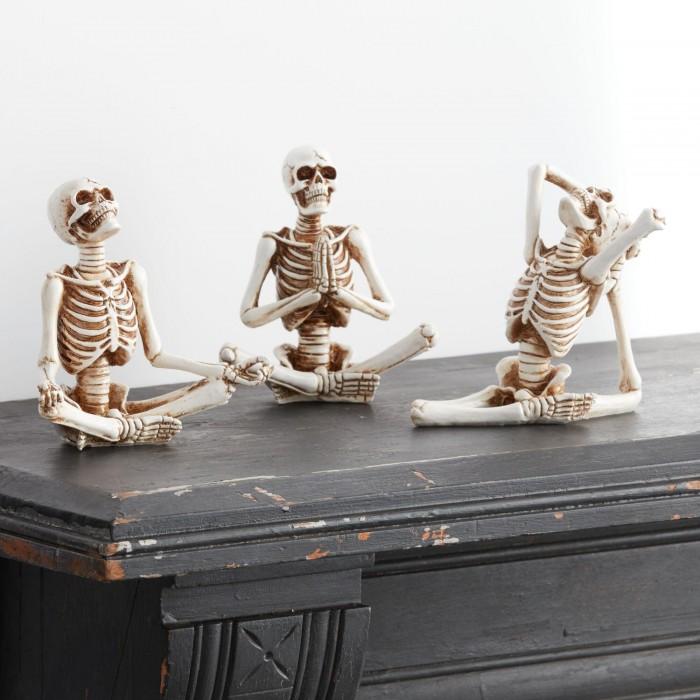 Yoga Skeletons on black mantle