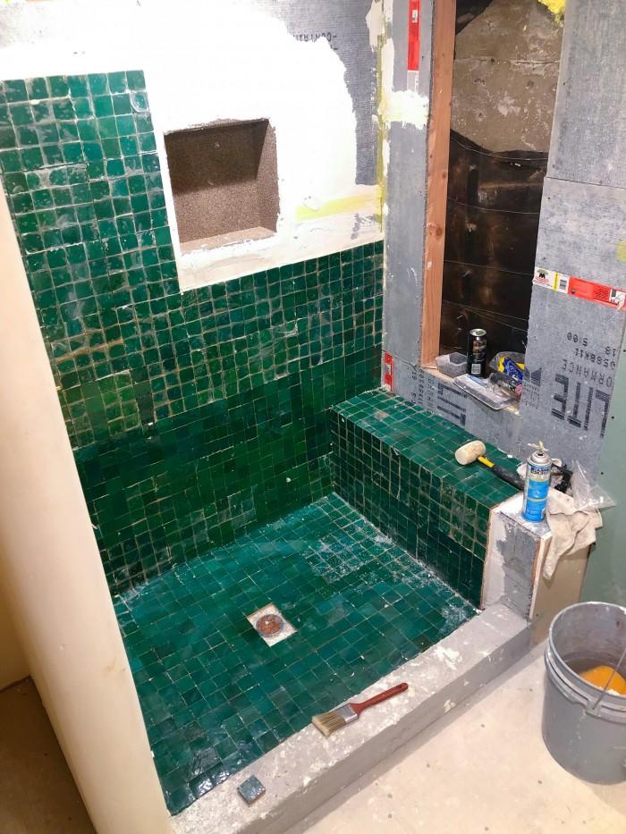 Under construction green zellige tile shower