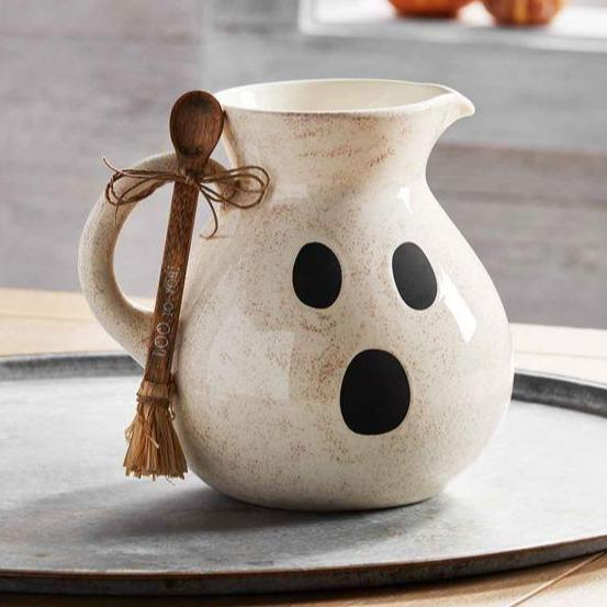 Ghost pitcher with wooden spool on a large tray