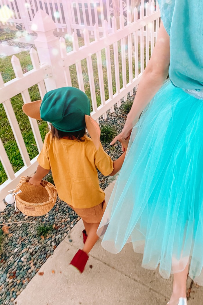 Child in Gus Gus Halloween costume and mom in cinderella costume walking